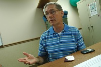 Bill Beck offers his business cards at a meeting of Tea Party supporters