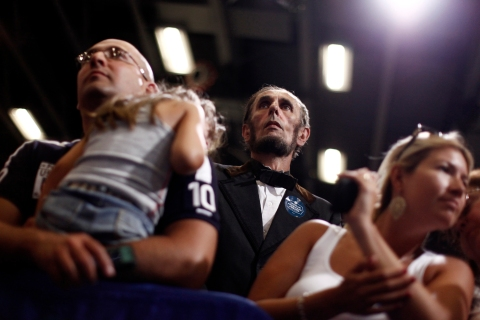 A man dressed as Abraham Lincoln listens as President Barack Obama speaks during a campaign rally in Cedar Rapids.
