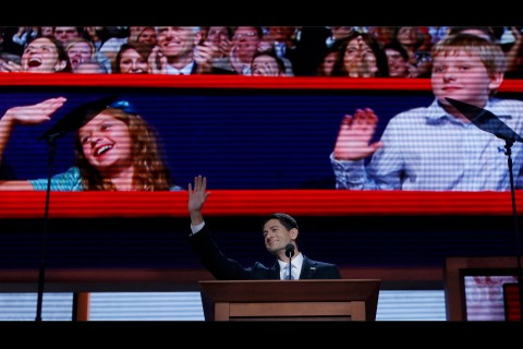 Republican vice presidential nominee Paul Ryan's children are seen on a video screen as he accepts the nomination while addressing delegates during the third session of the Republican National Convention in Tampa