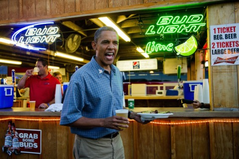 President Barack Obama gets a beer and a pork chop as he visits the Iowa State Fair in Des Moines, Iowa, on August 13, 2012.