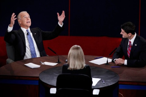 U.S. Vice President Joe Biden makes a point in front of Republican vice presidential nominee Paul Ryan