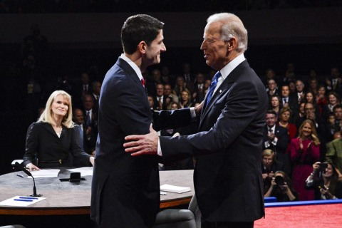 Moderator Martha Raddatz watches as Vice President Joe Biden and Vice Presidential candidate Paul Ryan greet each other as they arrive at the vice presidential debate at Centre College in Danville, Ky., on Thursday, Oct. 11, 2012.