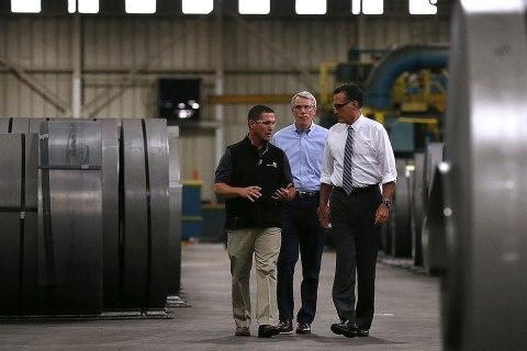 Image: Republican presidential candidate Mitt Romney and U.S. Sen. Rob Portman take a tour of Worthington Industries on October 25, 2012 in Cincinnati, Ohio.