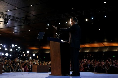 image: Mitt Romney stands at the podium before conceding the presidency during his campaign election night event at the Boston Convention & Exhibition Center on Nov. 7, 2012 in Boston, Mass.