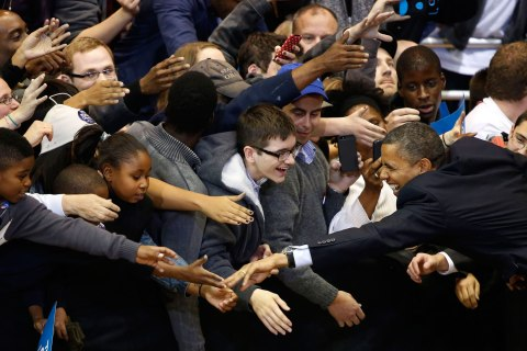 President Barack Obama reaches out to shake hands after he speaks at a campaign event at the University of Cincinnati, Nov. 4, 2012.
