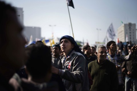 image: An Egyptian man looks on as thousands protesters gather in Cairo's landmark Tahrir square, Nov. 30, 2012.