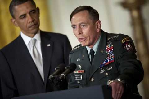 image: President Barack Obama listens while then-nominee for CIA Director, Gen. David Petraeus, speaks in the East Room of the White House in Washington, April 28, 2011.