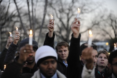 image: Supporters of gun control legislation hold candles and placards during a rally in front of the White House to pay respect for the victims of a deadly shooting spree at Sandy Hook Elementary School in Newtown, Conn., on Friday, Dec. 14, 2012.