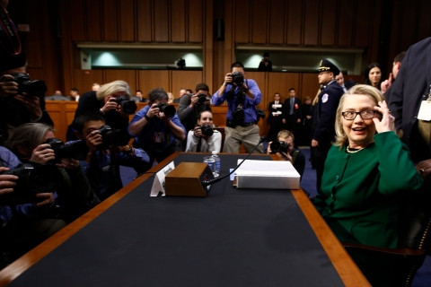 U.S. Secretary of State Hillary Clinton sits down to testify in Washington on the September attack on U.S. diplomatic sites in Libya