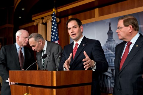 Sen. Marco Rubio center, answers a reporter's question as he and a bipartisan group of leading senators announce that they have reached agreement on the principles of sweeping legislation to rewrite the nation's immigration laws, during a news conference at the Capitol in Washington, D.C., on Jan. 28, 2013.
