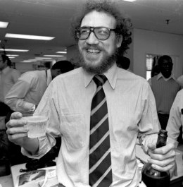 image: The Philadelphia Inquirer's Richard Ben Cramer celebrates with colleagues in the Inquirer city room after winning the Pulitzer Prize for his reporting in the Middle East, April 16, 1979.