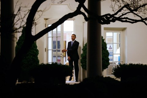 image: President Barack Obama walks out of the Oval Office as he departs the White House in Washington, Jan. 1, 2013.