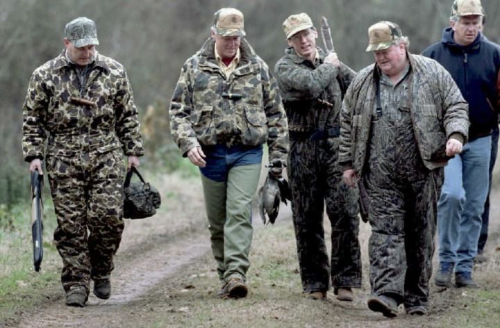 Former President Bill Clinton holds two ducks that he shot earlier while hunting with friends in Cotton Plant, Ark., on Jan. 3, 1995.