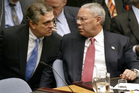U.S. Secretary of State Colin Powell talks with CIA Director George Tenet after his presentation to the U.N. Security Council in New York