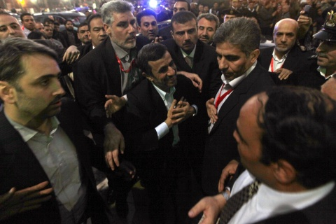 Iran's President Mahmoud Ahmadinejad greets people as he visits the Al-Hussein mosque in old Cairo