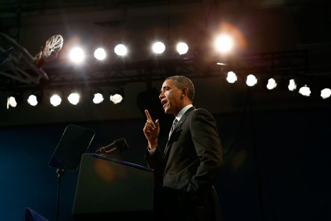 President Barack Obama speaks about strengthening the economy for the middle class and measures to combat gun violence during a visit to Hyde Park Academy in Chicago on Feb. 15, 2013.