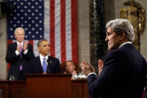 U.S. Secretary of State John Kerry applauds President Barack Obama