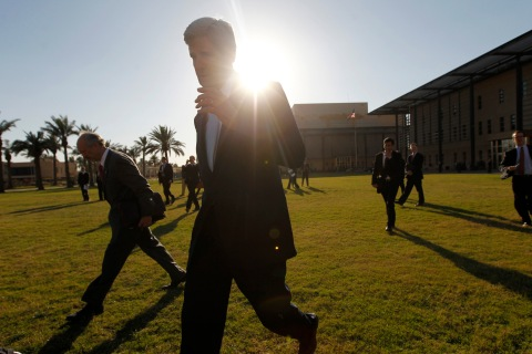 U.S. Secretary of State John Kerry walks to his helicopter on the grounds of the U.S. Embassy in Baghdad