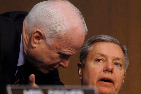 Senators McCain and Graham confer at the Senate Armed Services Committee in Washington