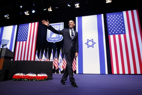 U.S. President Obama acknowledges the audience after delivering a speech on mideast policy at the Jerusalem Convention Center