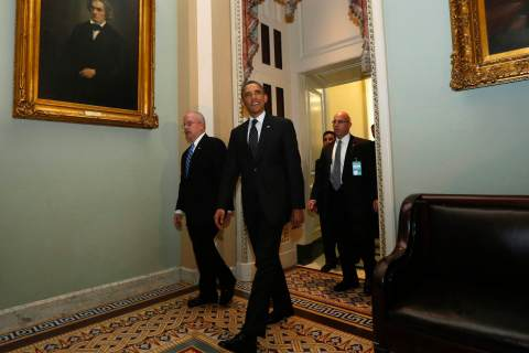 U.S. President Obama departs the U.S. Capitol after meeting with Senate Democrats in Washington.