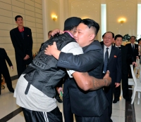 North Korean leader Kim Jong-Un and former NBA basketball player Dennis Rodman hug in Pyongyang