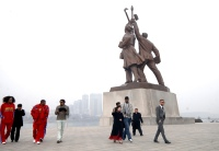 Former NBA star Dennis Rodman (2nd R, front) and his company visit the Tower of Juche Idea in Pyongyang