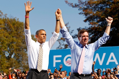 U.S. President Obama acknowledges the crowd with Virginia Senator Warner during a campaign rally in Richmond