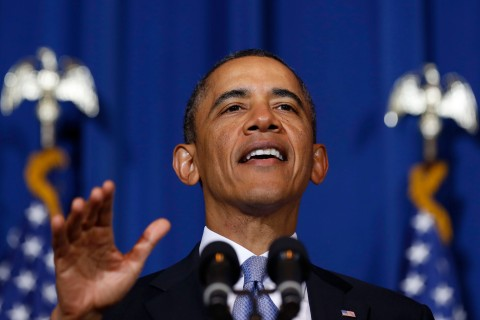 U.S. President Barack Obama talks on stage at the Department of Interior in Washington