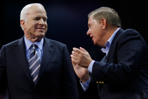 U.S. Republican presidential nominee McCain talks to U.S. Senator Graham at a campaign rally in Fayetteville