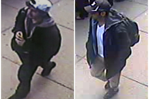 Two images taken from surveillance video of men the FBI are calling suspect No. 2, in white cap, and suspect No. 1, in black cap, as they walk near each other through the crowd before the explosions at the Boston Marathon on April 15, 2013.