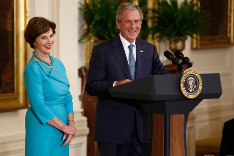 Former U.S. President Bush and former first lady Laura speak following unveiling of their official White House portraits during ceremony in Washington