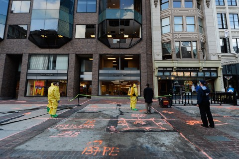 The Boston Fire Department hazardous-materials team clean the blast site near the Boston Marathon finish line one week after the FBI handed over Boylston Street back to the city in Boston, on April 22, 2013.