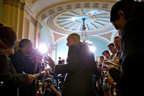 Senate Majority Leader Harry Reid, D-Nev., speaks with reporters following a Democratic strategy session at the Capitol in Washington.