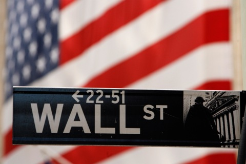 A Wall St. sign is seen outside of the New York Stock Exchange