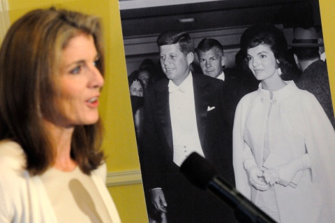 Kennedy stands near a portrait of her parents as she helps launch a new online trove of her father's official and personal records at the National Archives in Washington