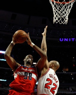 Washington Wizards' Jason Collins goes to the basket against Chicago Bulls' Taj Gibson during the first half of their NBA basketball game in Chicago, Illinois