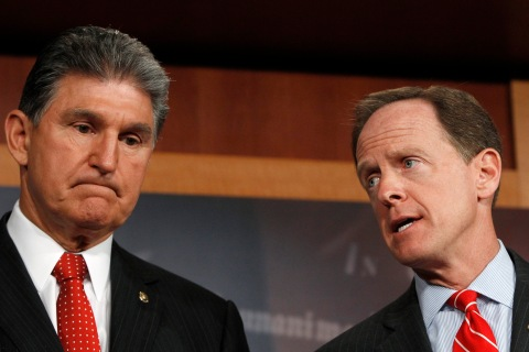 Senator Toomey and Senator Manchin hold news conference on firearms background checks on Capitol Hill in Washington