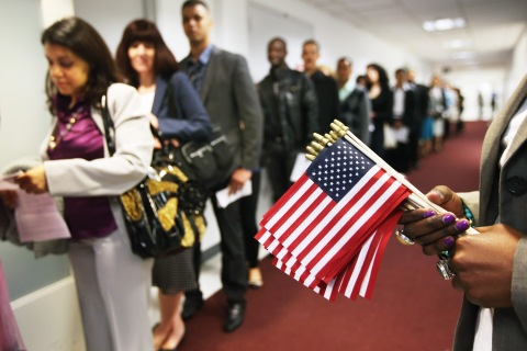 Immigrants wait to become American citizens ahead of a naturalization ceremony at the U.S. Citizenship and Immigration Services (USCIS) office in New York City, on May 17, 2013.