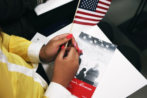 A woman waits to become an American citizen at a naturalization ceremony held at the U.S. Citizenship and Immigration Services (USCIS), office in New York City, on May 17, 2013.