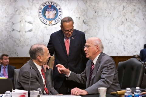 From right: Senate Judiciary Committee Chairman Patrick Leahy confers with Senators Chuck Schumer and Chuck Grassley as the Senate Judiciary Committee assembles to work on a landmark immigration bill, on Capitol Hill in Washington, D.C., on May 20, 2013.