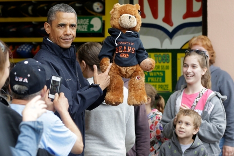 U.S. President Barack Obama holds up a stuffed bear that New Jersey Governor Chris Christie won at the boardwalk during their visit to Point Pleasant, NJ., on May 28, 2013.