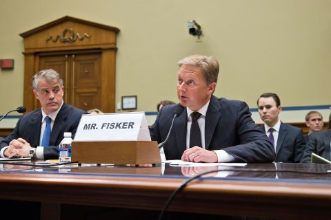 Henrik Fisker, founder of Fisker Automotive, right, testifies on Capitol Hill in Washington, April 24, 2013.