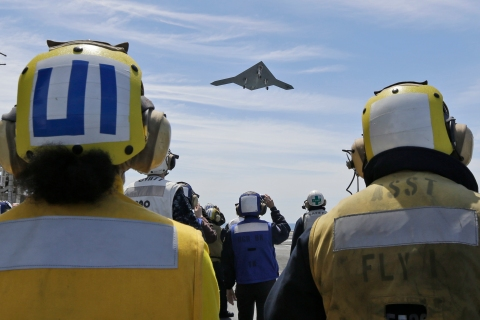 An X-47B Navy drone does a flyby the USS George H.W. Bush after it was launched from the ship off the coast of Virginia, on May 14, 2013.