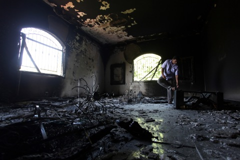 A Libyan man investigates the inside of the U.S. Consulate after an attack that killed four Americans, in Benghazi, Libya, on Sept. 12, 2012, in Benghazi, Libya.
