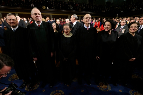 U.S. Supreme Court Justices await the start of President Obama's State of the Union speech on Capitol Hill in Washington
