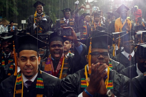 Graduates of the class of 2013 react to their commencement address given by U.S. President Obama during a spring downpour at Morehouse College in Atlanta