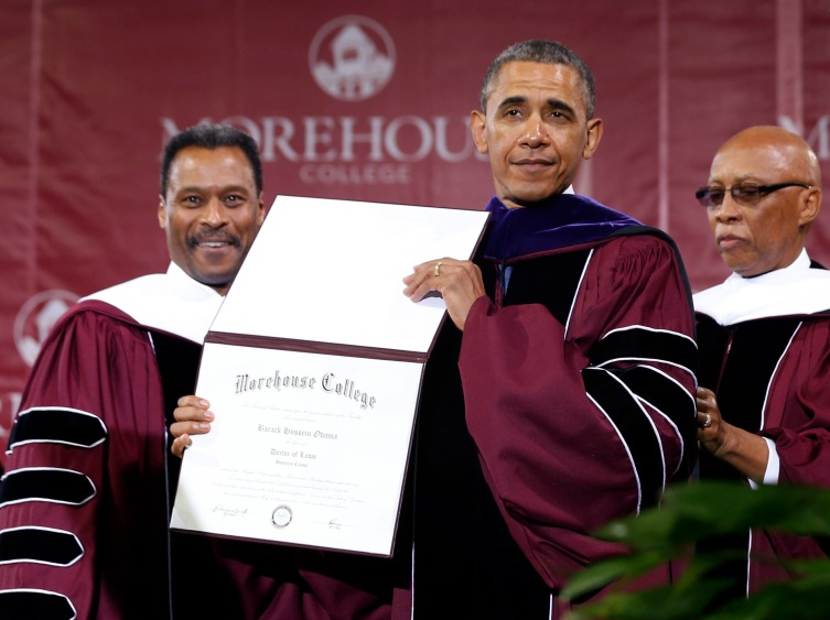U.S. President Obama poses with honorary Doctor of Laws degree he received from Chairman of Board of Trustees Davidson and College President Wilson at graduation ceremony of class of 2013 at Morehouse College in Atlanta