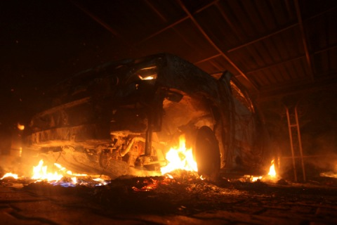 A burning car is seen at the U.S. Consulate in Benghazi during a protest