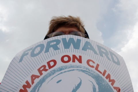 A demonstrator carries a sign during a march against the Keystone XL pipeline in Washington
